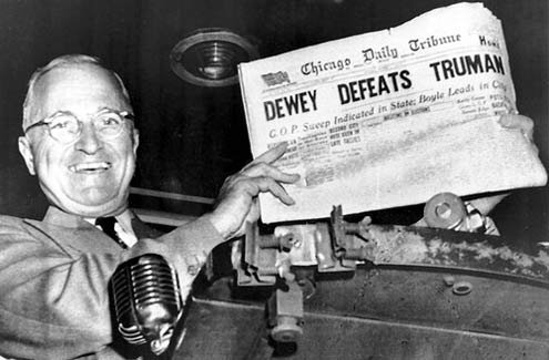 Truman holds up Chicago's early edition headline at the end of the 1948 race.