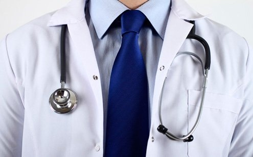 Conservative and professional attire helps with credibility but medical judgment comes first.